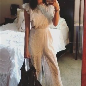 White cloth jumpsuit with tie on back